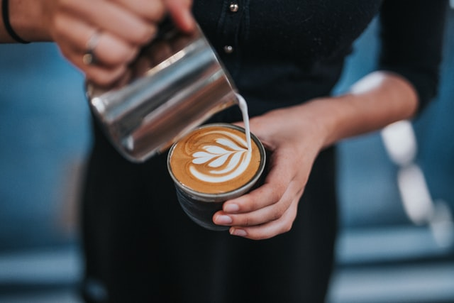 A barista preparing a coffee.