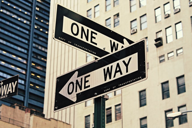 Street signs saying 'one way'